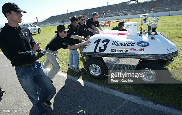 Team Ensco's Noah Jacobson mans the joystick as David is escorted off the infield during qualification inspection and demonstration of autonomous...