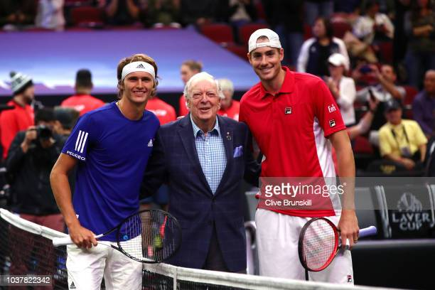 Team Europe Alexander Zverev of Germany and Team World John Isner of the United States pose with former tennis player Fred Stolle of Australia prior...