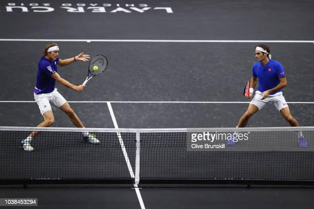 Team Europe Alexander Zverev of Germany returns a shot with Team Europe Roger Federer of Switzerland during their Men's Doubles match against Team...