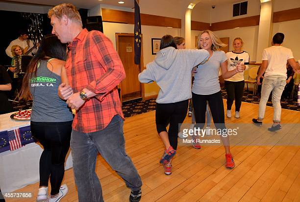 Team Europe and Team USA join together for traditional Ceilidh dancing at the Angus Hotel during the 2014 Junior Ryder Cup Previews on September 19...