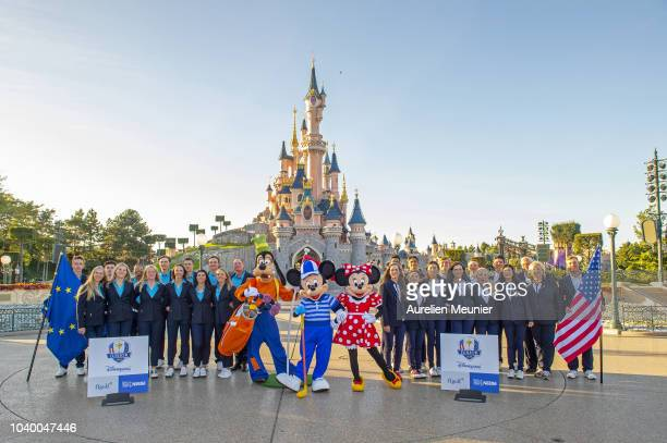 Team Europe and team USA pose in front of the Magic Castle after the 2018 Junior Ryder Cup at Disneyland Paris on September 25 2018 in Paris France