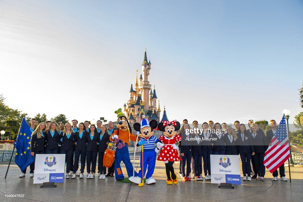 Team Europe and team USA pose in front of the Magic Castle