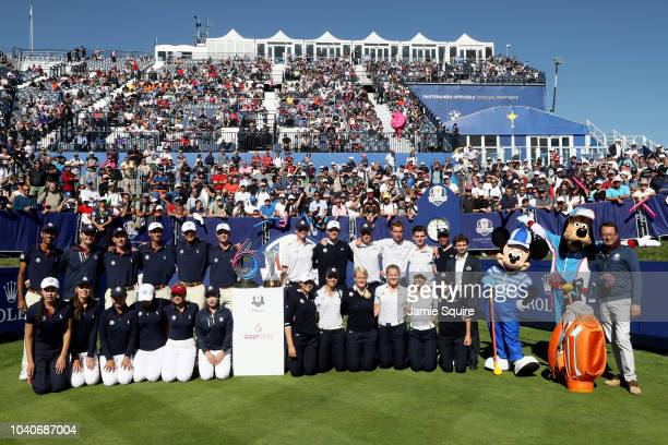 Team Europe and Team USA pose with Mickey Mouse and Goofy during the Junior Ryder Cup GolfSixes ahead of the 2018 Ryder Cup at Le Golf National on...