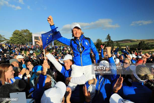 Team Europe captain Catriona Matthew is hoisted onto her players shoulders to celebrate her teams win during the final day singles matches of the...