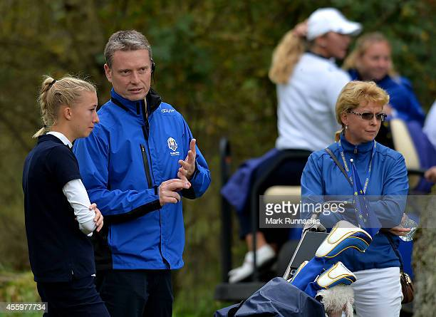 Team Europe Captain Stuart Wilson consoles Alexandra Forsterling of Team Europe after she lost her match during the final day Singles matches at the...