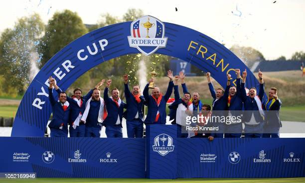 Team Europe celebrate after winning The Ryder Cup after the singles matches of the 2018 Ryder Cup at Le Golf National on September 30, 2018 in Paris,...