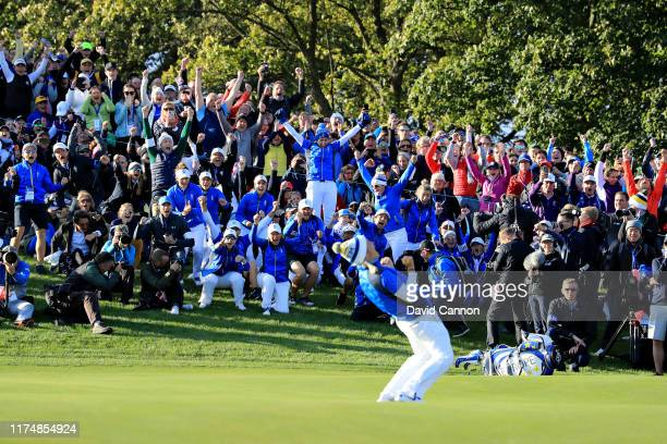 Team Europe celebrate as Suzann Pettersen of Team Europe putts to win her match and the tournament during the final day singles matches of the...