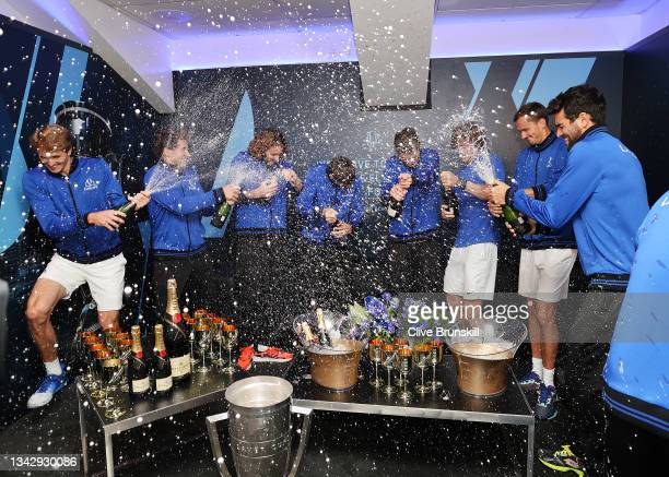 Team Europe celebrate in the locker room with Champagne and the Laver Cup trophy after defeating Team World 14-1 during Day 3 of the 2021 Laver Cup...