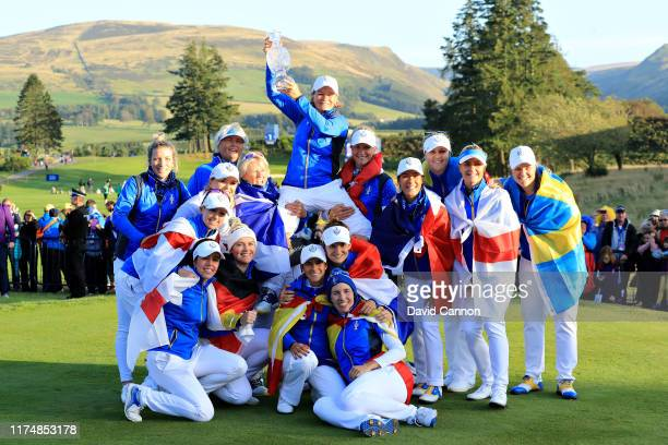 Team Europe celebrate winning the Solheim Cup during the final day singles matches of the Solheim Cup at Gleneagles on September 15 2019 in...