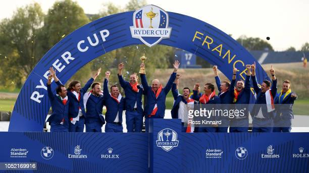 Team Europe celebrates after winning The Ryder Cup after the singles matches of the 2018 Ryder Cup at Le Golf National on September 30 2018 in Paris...