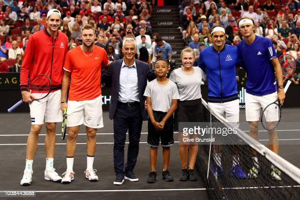 Team Europe Grigor Dimitrov of Bulgaria and Team Europe celebrate with the trophy after winning the Laver Cup on day three of the 2018 Laver Cup at...