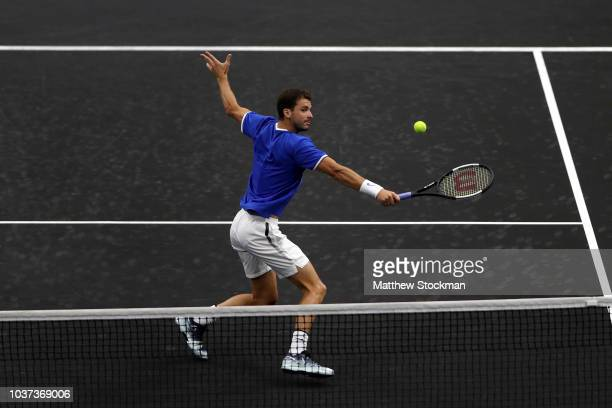 Team Europe Grigor Dimitrov of of Bulgaria returns a shot against Team World Frances Tiafoe of the United States during their Men's Singles match on...