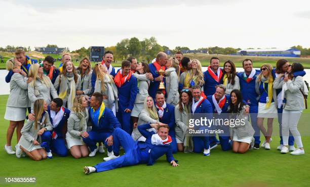 Team Europe kiss their partners as they celebrate after winning The Ryder Cup during singles matches of the 2018 Ryder Cup at Le Golf National on...