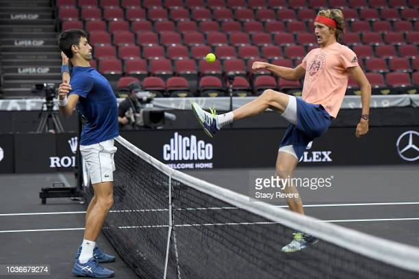 Team Europe Novak Djokovic of Serbia and Team Europe Alexander Zverev of Germany warm up prior to the Laver Cup at the United Center on September 20...