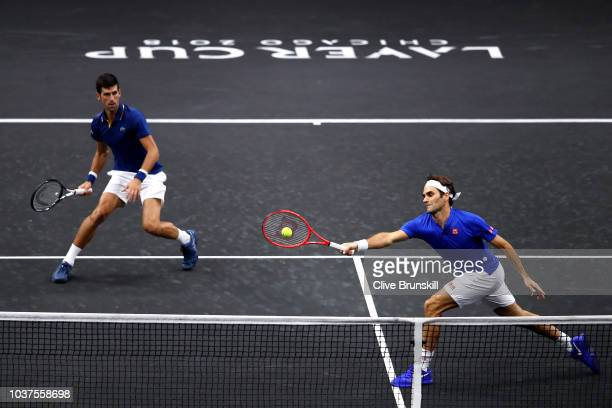 Team Europe Novak Djokovic of Serbia and Team Europe Roger Federer of Switzerland return a shot against Team World Jack Sock of the United States and...