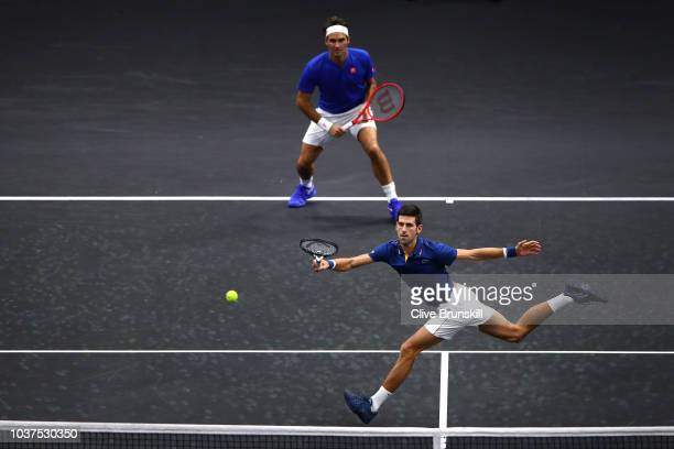 Team Europe Novak Djokovic of Serbia returns a shot with Team Europe Roger Federer of Switzerland against Team World Jack Sock of the United States...
