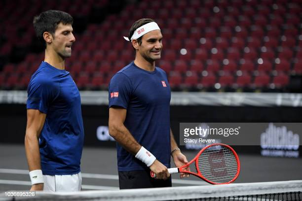 Team Europe Novak Djokovic of Serbia talks with Team Europe Roger Federer of Switzerland during practice prior to the Laver Cup at the United Center...