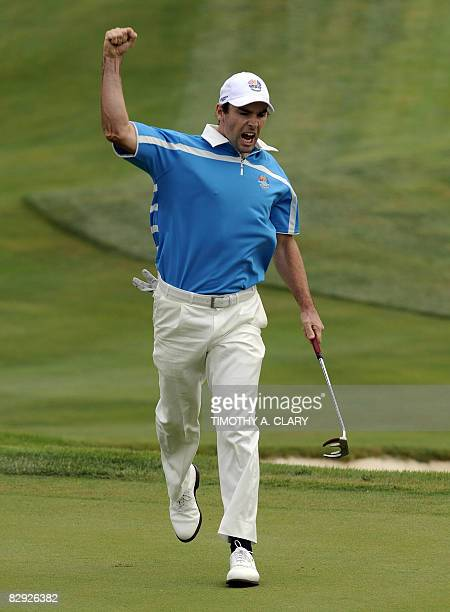 Team Europe player Oliver Wilson birdies 17th hole to win the hole and the match against Phil Mickelson and Anthony Kim of the United States during...