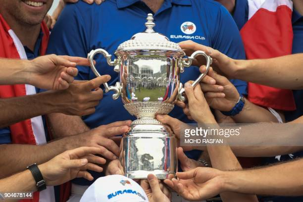 Team Europe players hold the trophy after they won the 2018 Eurasia Cup Golf tournament at the Glenmarie Golf and Country club in Shah Alam near...