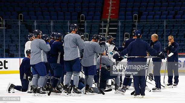 Team Europe players listen to Ralph Krueger's instructions during a practice at the Centre Videotron on September 7, 2016 in Quebec City, Quebec,...