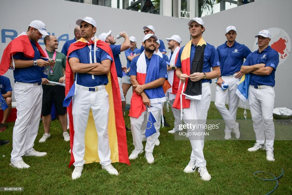 Team Europe players wait for the prize giving ceremony after winning the 2018 Eurasia Cup Golf tournament at the Glenmarie Golf and Country club in Shah Alam, near Kuala Lumpur on January 14, 2018. /