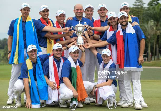 Team Europe poses for pictures with their trophy after winning the 2018 Eurasia Cup Golf tournament at the Glenmarie Golf and Country club in Shah...