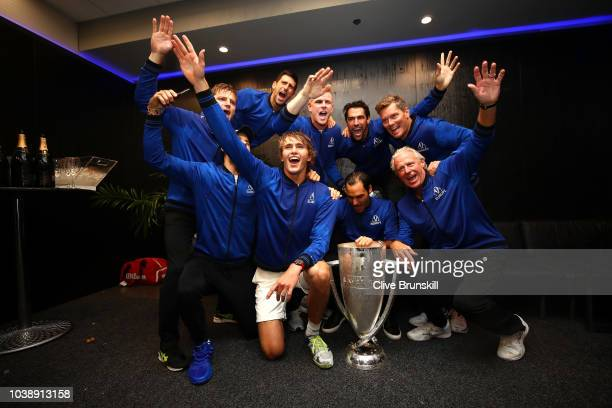 Team Europe poses with the trophy in the locker room after their Men's Singles match on day three to win the 2018 Laver Cup at the United Center on...