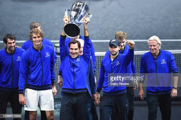 Team Europe Roger Federer of Switzerland and Team Europe celebrate with the trophy after during winning the Laver Cup on day three of the 2018 Laver...