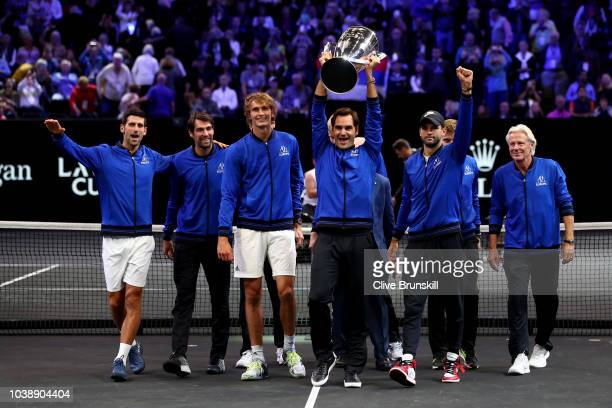 Team Europe Roger Federer of Switzerland and Team Europe celebrates with the Trophy after during winning the Laver Cup on day three of the 2018 Laver...