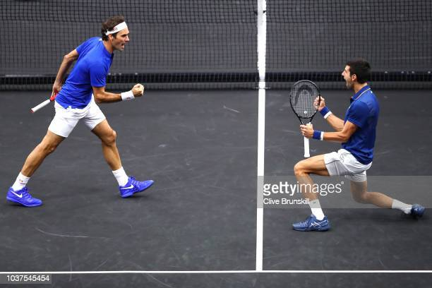Team Europe Roger Federer of Switzerland and Team Europe Novak Djokovic of Serbia celebrate a point against Team World Jack Sock of the United States...