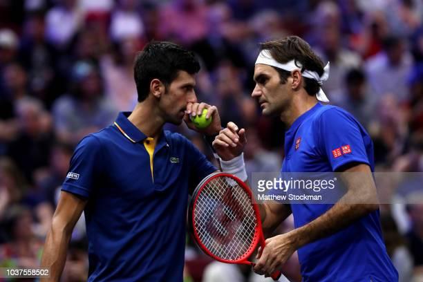 Team Europe Roger Federer of Switzerland and Team Europe Novak Djokovic of Serbia react against Team World Jack Sock of the United States and Team...