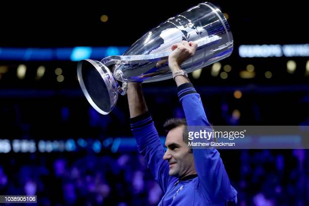 Team Europe Roger Federer of Switzerland celebrates with the trophy after winning the Laver Cup on day three of the 2018 Laver Cup at the United...