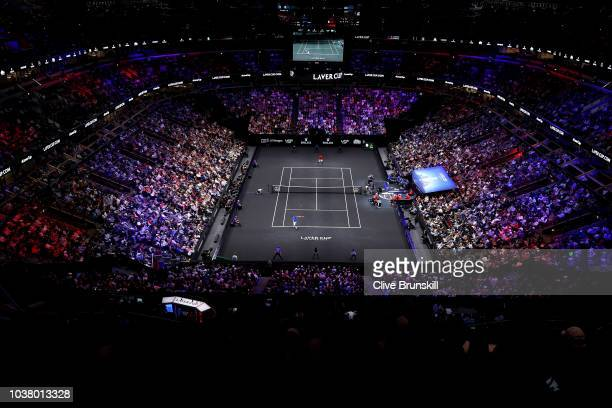 Team Europe Roger Federer of Switzerland returns a shot against Team World Nick Kyrgios of Australia during their Men's Singles match on day two of...