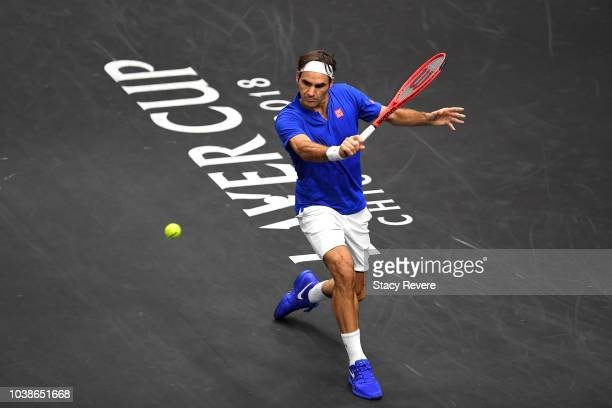 Team Europe Roger Federer of Switzerland returns a shot against Team World John Isner of the United States during their Men's Singles match on day...