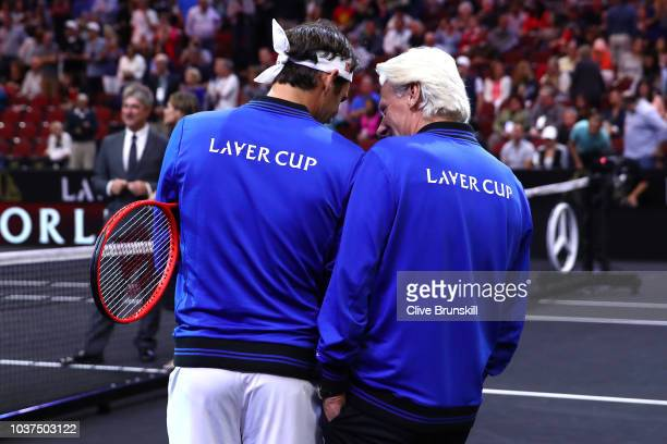 Team Europe Roger Federer of Switzerland talks with Team Europe Captain Bjorn Borg of Sweden prior to his Men's Doubles match on day one of the 2018...