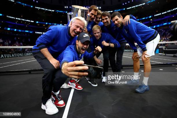 Team Europe take a selfie with the trophy after their Men's Singles match on day three after winning the 2018 Laver Cup at the United Center on...