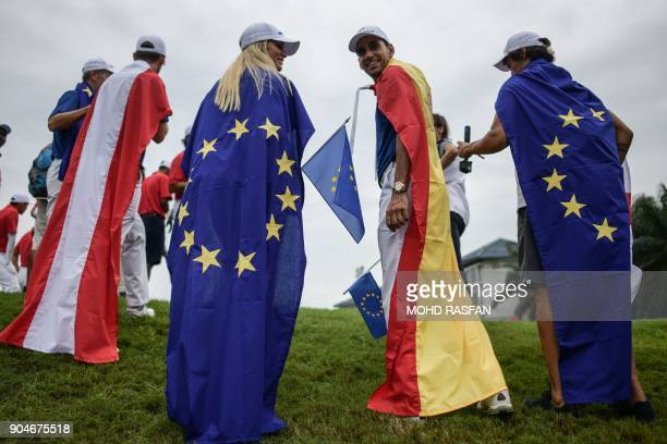 Team Europe's Rafa Cabrera Bello of Spain smiles after his team won the 2018 Eurasia Cup Golf tournament at the Glenmarie Golf and Country club in...