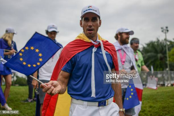 Team Europe's Rafa Cabrera Bello of Spain waves the European Union flag after his team won the 2018 Eurasia Cup Golf tournament at the Glenmarie Golf...