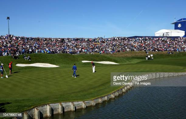 Team Europe's Rory McIlroy and Team USA's Justin Thomas on the first green