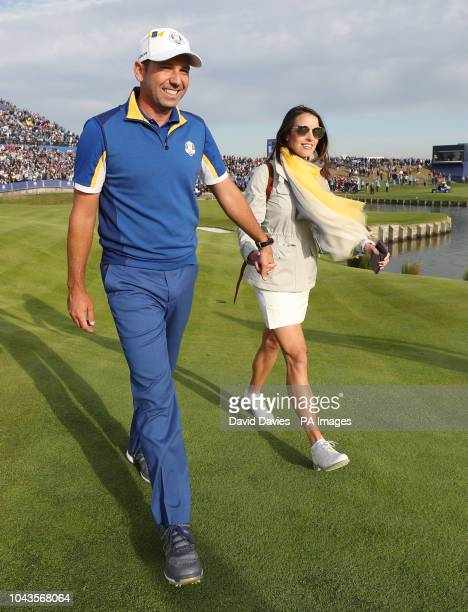 Team Europe's Sergio Garcia celebrates winning the Ryder Cup with wife Angela at Le Golf National SaintQuentinenYvelines Paris