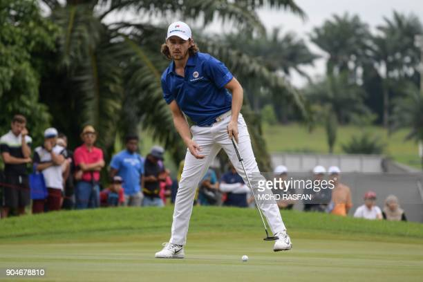 Team Europe's Tommy Fleetwood of England reacts after missing a putt during the singles matches of the 2018 Eurasia Cup Golf tournament at the...