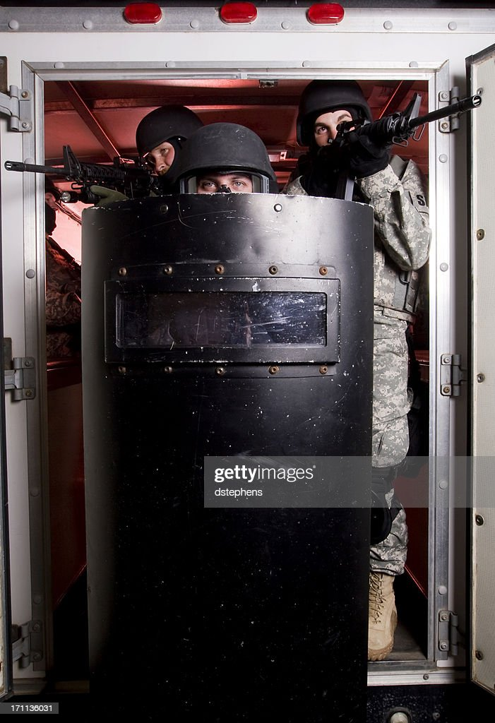 SWAT Team exiting : Stock Photo