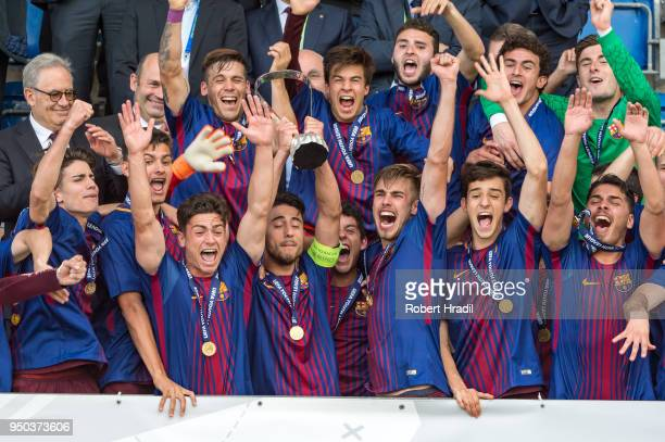 Team FC Barcelona celebrates with the trophy during the UEFA Youth League Final match between Chelsea FC and FC Barcelona at Colovray Sports Centre...