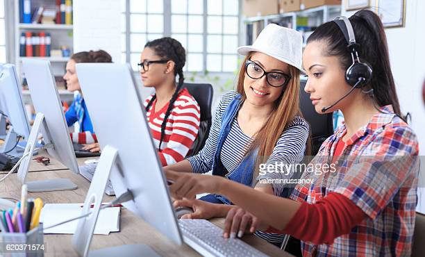 Team female call centre assistants talking in office