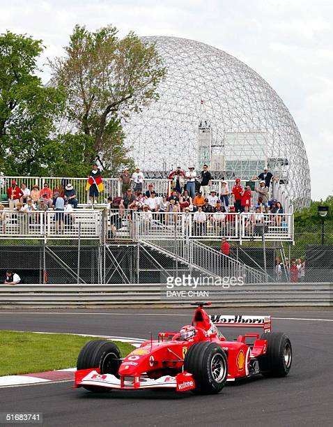 Team Ferrari's German driver Michael Schumacher passes the Biosphere in the hairpin turn during the final practice for the Canadian Grand Prix Sunday...