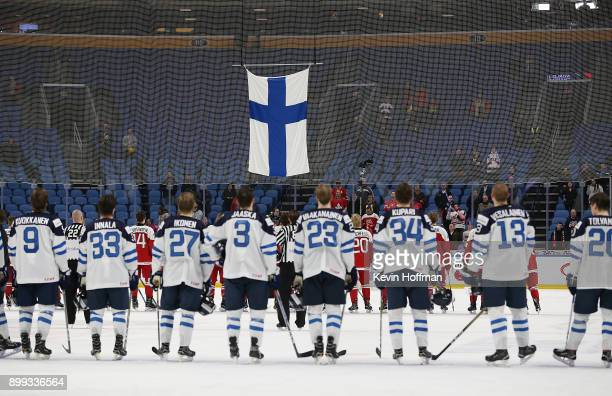 Team Finland and Team Denmark during the Finland national anthem after the game at the IIHF World Junior Championship at KeyBank Center on December...
