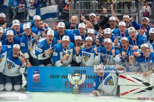 Team Finland celebrates the win with the trophy after during the 2019 IIHF Ice Hockey World Championship Slovakia final game between Canada and...