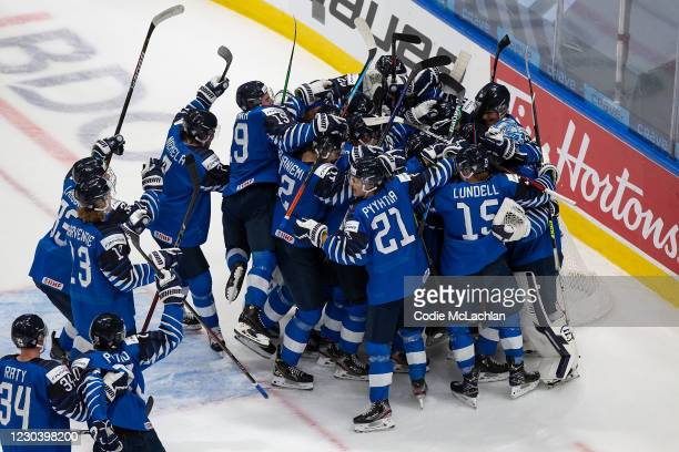 Team Finland celebrates victory over Sweden during the 2021 IIHF World Junior Championship quarterfinals at Rogers Place on January 2, 2021 in...