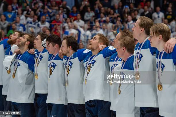 Team Finland lines up for national anthem during the 2019 IIHF Ice Hockey World Championship Slovakia final game between Canada and Finland at Ondrej...