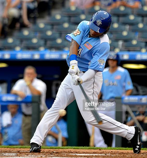 Team first baseman Jonathan Singleton drive the ball for a single during the All-Star Futures baseball game at Kauffman Stadium in Kansas City,...